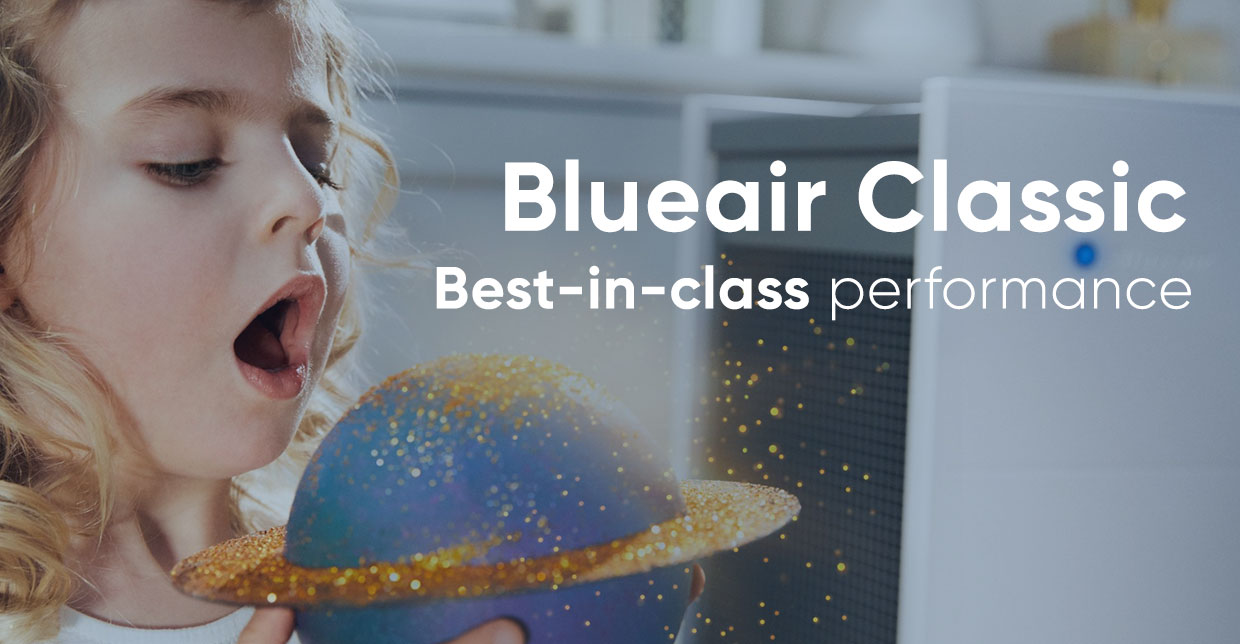 baby blowing stardust from earth with a Blueair Classic behind her